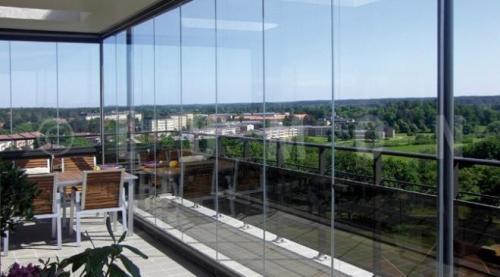 گسترده ترین مجموعه تولیدوفروش شیشه بالکن ریلی وسقف متح